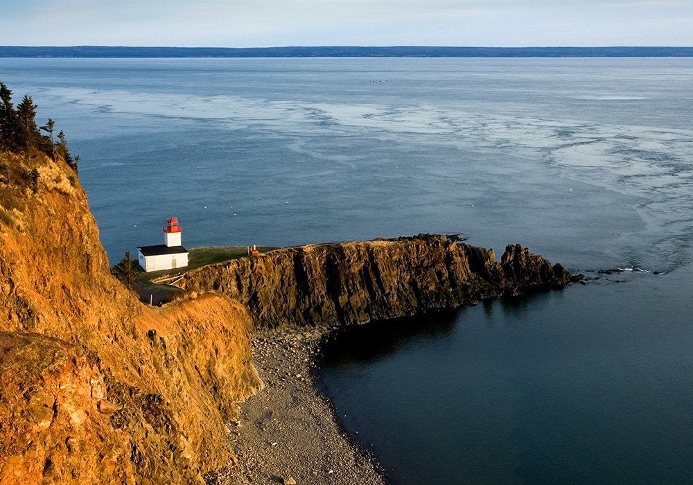 An image rendering of the bay of fundy and a lighthouse.