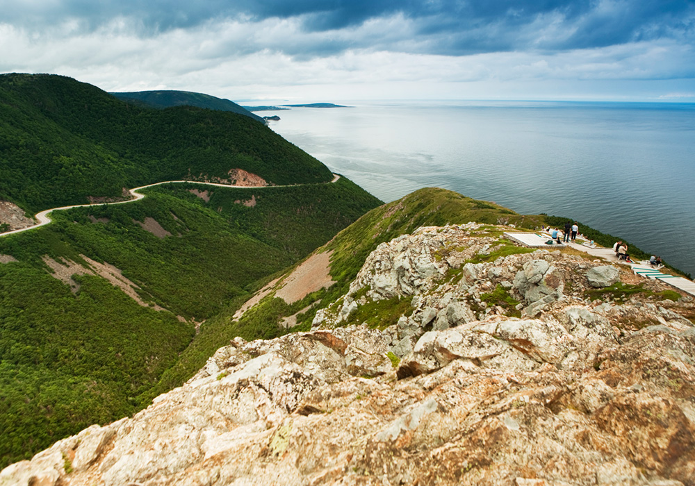An image rendering of people having a picnic on the Cabot Trail.