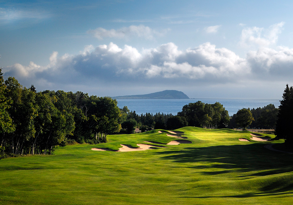 An image rendering of a golf course, overlooking the ocean.